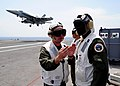 US Navy 100522-N-7282P-040 Capt. Ross Myers explains flight deck operations to Lt. Gen. Edward A. Rice Jr. aboard USS George Washington (CVN 73).jpg