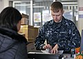 US Navy 101116-N-2013O-036 Logistics Specialist Seaman Jason Wilson, from Eden, N.C., assists a customer in the Fleet Industrial Supply Center Yok.jpg