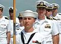 US Navy 110511-N-VA590-305 Seaman Nicholas Killion tands as guide-on bearer for the U.S. Navy company participating in the opening ceremony of CARA.jpg