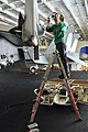 US Navy 110625-N-EE987-045 Aviation Machinist's Mate Airman Journey Domingo, from Manteca, Calif., installs a 159 Canoe panel onto an F-A-18 Super.jpg