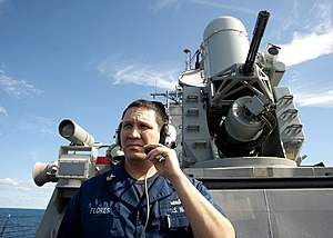 US Navy 120131-N-NL401-195 Fire Controlman 1st Class David Flores conducts a pre-fire check with the close-in weapon system.jpg