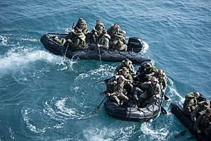 US Navy 120208-N-SS993-099 Marines from the 31st Marine Expeditionary Unit (31st MEU) deploy in combat rubber raid crafts from the well deck of the.jpg