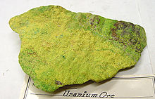 Block of yellow-green stone with rough surface.