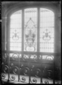 View of a stained glass window depicting the front of a train, at Dunedin Railway Station. ATLIB 294731.png