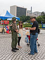 Visitor Talking with Soldier Holded Boy 20140607.jpg