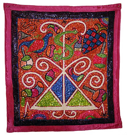 "A large sequined Vodou ""drapo"" or flag by the artist George Valris, depicting the veve, or symbol, of the loa Loko Atison. VoodooValris.jpg"