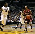 Washington vs Washington State at 2011 Pac-10 Tournament - Faisal Aden dribbles vs 2 UW players.jpg