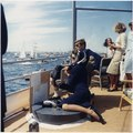 Watching the America's Cup Race. Mrs. Kennedy, President Kennedy, others. Off Newport, RI, aboard the USS Joseph P.... - NARA - 194214.tif