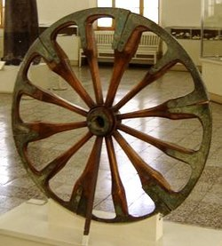 A spoked wheel on display at The National Museum of Iran, in Tehran. The wheel is dated late 2nd millennium BC and was excavated at Choqa Zanbil.