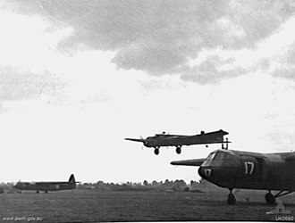 RAF Brize Norton - An Armstrong Whitworth Whitley glider tug coming in to land between Airspeed Horsa gliders at RAF Brize Norton, October 1943