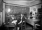 Woman working in an office (4903875622).jpg