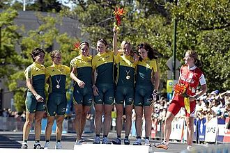 """Nicole Cooke - Melbourne 2006 Commonwealth Games. Team Australia celebrate beating World No 1 Nicole Cooke of Wales, the defending Champion, who Team Wales had sent to compete on her own.  Team Wales sent a full squad of six for the men's race, none of whom finished the race.  In her autobiography Cooke wrote """"By their decision the WCU had gifted Australia, Canada, England and New Zealand my head on a plate""""."""