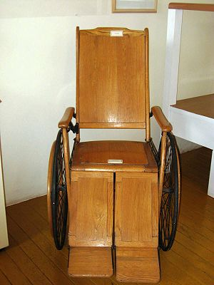 English: Wooden wheelchair dating to the early...
