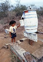 Wooden barrel postbox in the Galapagos Islands, 1983.jpg