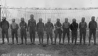 Chemical weapons in World War I - Football team of British soldiers with gas masks, Western front, 1916