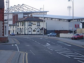 Turf Hotel - The Turf Hotel dwarfed by the Mold Road Stand