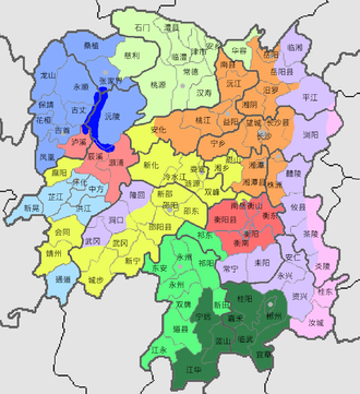 Xiang Chinese - Dialect map of Hunan Province. New Xiang orange, Old Xiang yellow, Chen-Xu Xiang light red. Xiangnan Tuhua dark green and medium green.  Note other dialects are shown in larger areas than in the next map. Hakka pink, Southwestern Mandarin light blue, medium blue, light green, and Waxiang dark blue