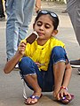 Young Girl with Ice Cream - Shimla - Himachal Pradesh - India (26434039872).jpg