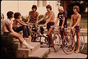 Youths Congregate Around the Front Steps of a Home in New Ulm, Minnesota, to Decide What to Do on a Summer Day... (4726927675).jpg