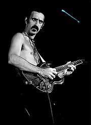 Frank Zappa in concert with his trademark moustache.