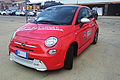 """15 - EXPO MILANO 2015 - 500e orange Electrically-powered citycar facing left.jpg"