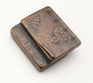 Japanese poetry - Edition of the Kokin Wakashū anthology of classic Japanese poetry with wood-carved cover, 18th century.