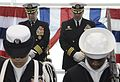 060112-N-4166B-004 Capt. Jeffrey Harley, (DESRON 9), left, and Cmdr. Jonathan Christian, bow their heads during the invocation at the beginning of the change of command ceremony.jpg