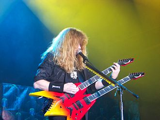 Multi-neck guitar - Dave Mustaine of Megadeth playing a Dean twin neck. Note the machine heads for the 12 string secondary strings on the edge of the body.