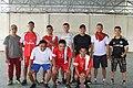 10 men in Indonesia posing after a futsal match.jpg