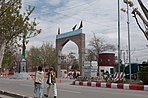 Residents of Ghazni City walk past newly constructed gates and monuments in Ghazni