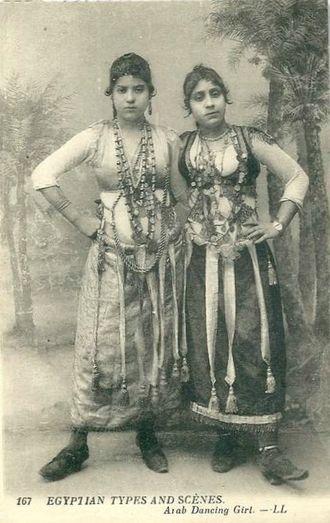 Ghawazi - Postcard photograph of two ghawazi posing in dance costume (c. 1900).