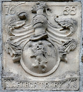 George Treby (judge) - Arms of Sir George Treby (d.1700) with crest: A demi-lion rampant. 1688 stone tablet affixed to facade of Plympton Guildhall, which building, together with Richard Stroud of Newnham, MP, he donated to the borough