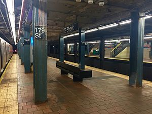 Jamaica–179th Street (IND Queens Boulevard Line) - Manhattan-bound platform. An R160 F train is visible on the Manhattan-bound local track.