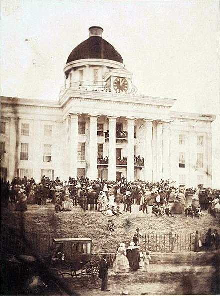 Davis being sworn in as provisional president on February 18, 1861, at the entrance to the Alabama State Capitol 1861 Davis Inaugural.jpg