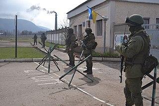 März 2014: Russische Soldaten ohne Hoheitsabzeichen blockieren die ukrainische Militärbasis Perewalne auf der Krim