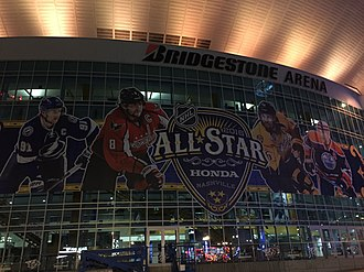Advert for the 2016 NHL All-Star Game outside Bridgestone Arena, featuring players from its clubs based in Canada, and the United States 2016 NHL All-Star Game (24751818606).jpg