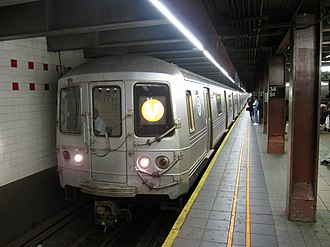 V (New York City Subway service) - A train made of R46 cars in V service at 34th Street–Herald Square, bound for Forest Hills–71st Avenue.
