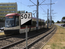 A railroad distance and gradient sign in Gdańsk, Poland. The 50‰ grade is equivalent to 5%.