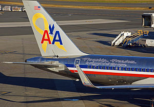 "American Airlines - AA ""Flagship Freedom"" Boeing 757-200, labeled with a ""yellow awareness ribbon"" symbol, representing support of the United States Armed Forces overseas operations."