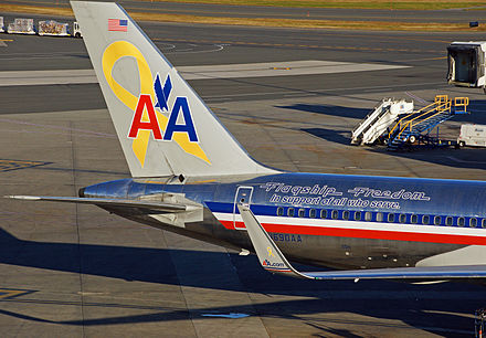 "AA ""Flagship Freedom"" Boeing 757-200, labeled with a ""yellow awareness ribbon"" symbol, representing support of the United States Armed Forces overseas operations. AA Flagship Freedom.JPG"