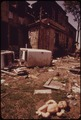 ABANDONED INNER CITY HOME AT 10212 WILBUR AVENUE ATTRACTS VANDALS AND LITTERBUGS - NARA - 550263.tif