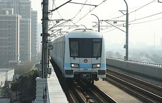 Line 9 (Shanghai Metro) - An AC09 series train enters Songjiang University Town station.