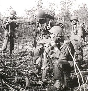 Walkie-talkie - Noemfoor, Dutch New Guinea, July 1944. A US soldier (foreground) uses a Handie-Talkie during the Battle of Noemfoor.