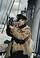 A Royal Navy officer using a sextant aboard a destroyer on convoy protection duties, 1942. TR92.jpg