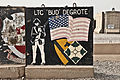 "A T-wall painted with a ""LTC BUD DEGROTE"" sign is seen at Camp Liberty, Iraq, July 7, 2011 110707-A-HR697-236.jpg"