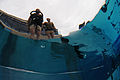 A U.S. Sailor, clad in scuba gear, prepares to jump into a swimming pool with a fellow Sailor during the second phase of Basic Underwater Demolition-SEAL training at Naval Amphibious Base Coronado in San Diego 110420-N-JR159-320.jpg