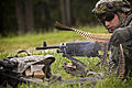 A U.S. Soldier assigned to Alpha Company, 1st Battalion, 114th Infantry Regiment, 50th Infantry Brigade Combat Team, New Jersey Army National Guard catches ammunition for an M240B machine gun during a live fire 130814-Z-NI803-123.jpg