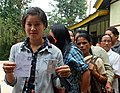 A first time female voter displaying her voter identity card, at a polling booth during the 4th Phase of Lok Sabha General Elections-2014, in Sikkim on April 12, 2014.jpg