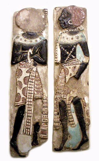 A pair of Nubians, from the royal palace adjacent to the temple of Medinet Habu, from the reign of Ramesses III (1182-1151 BCE). A pair of Nubians from the royal palace adjacent to the temple of Medinet Habu, from the reign of Ramesses III (1182-1151 BC).jpg