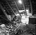 "A sniper from ""C"" Company, 5th Battalion, The Black Watch, 51st (Highland) Division, in position in the loft space of a ruined building in Gennep, Holland, 14 February 1945. B14628.jpg"